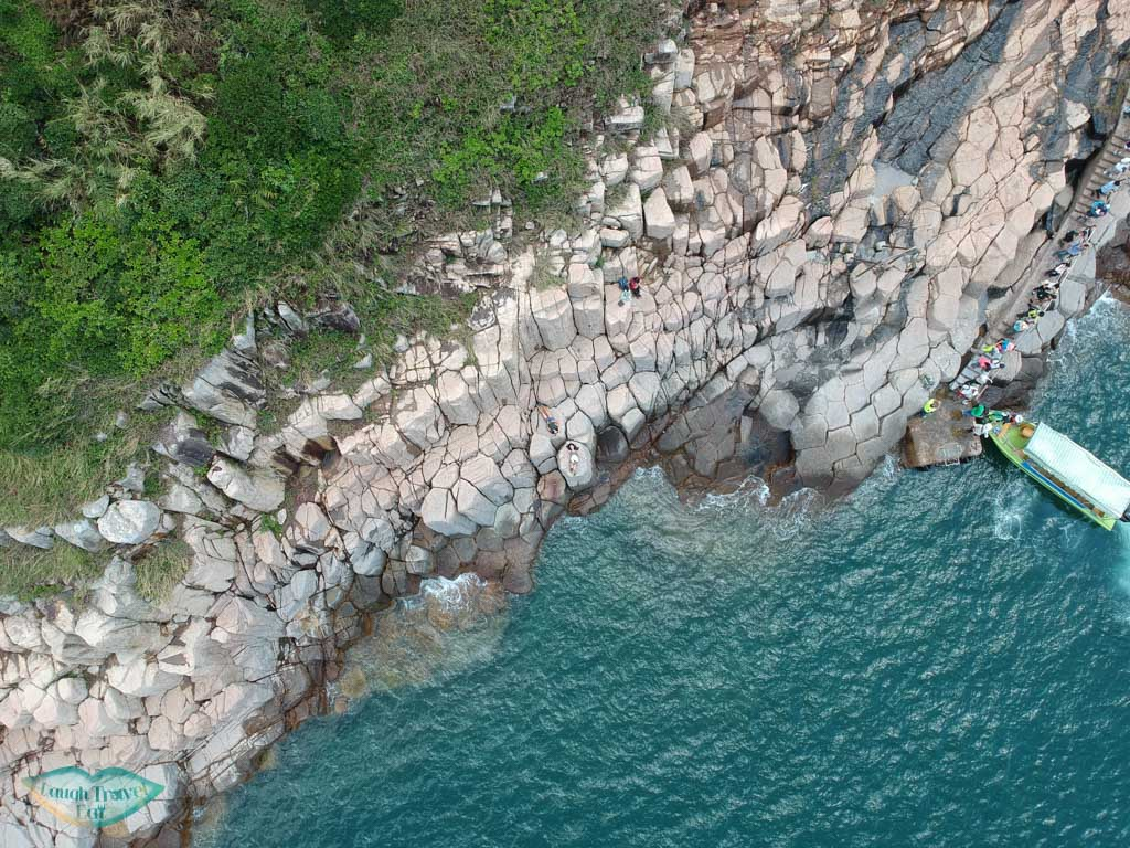 birds eye view hexagonal columns and boat north ninepin island sai kung hong kong - Laugh Travel Eat