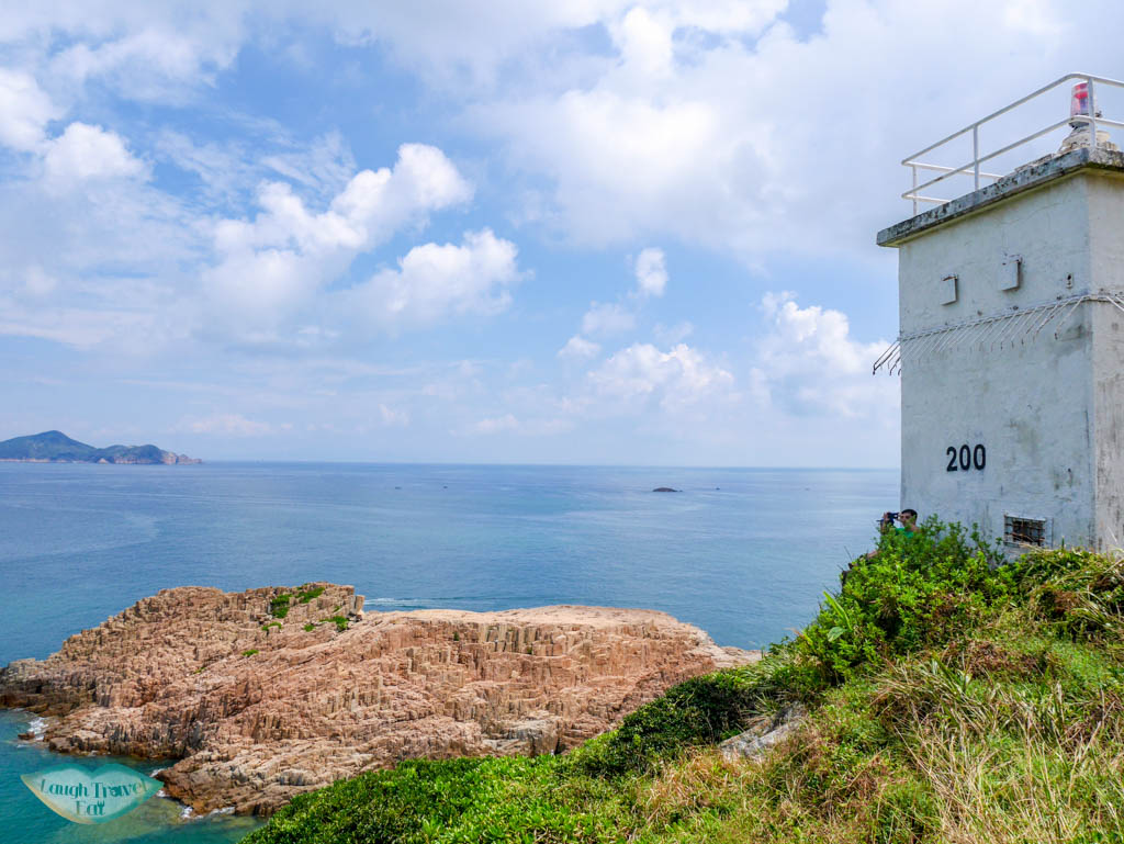 lighthouse and view of hok tsai pai north ninepin island sai kung hong kong - Laugh Travel Eat