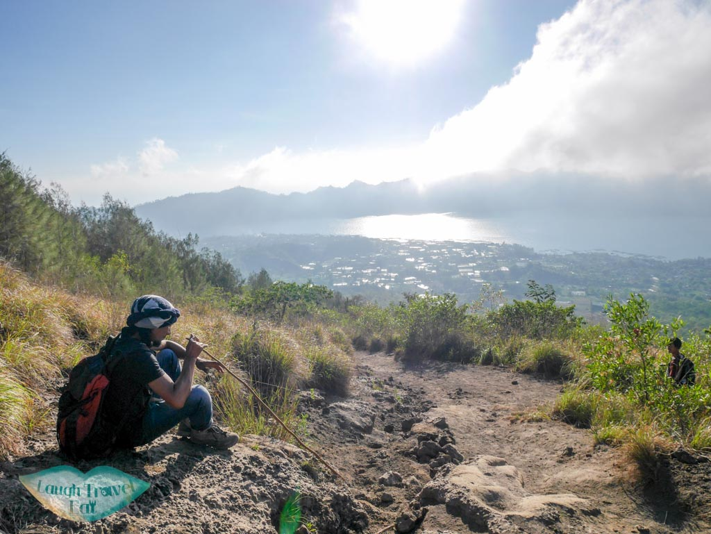 our tour guide going down Mount Batur bali indonesia - laugh travel eat