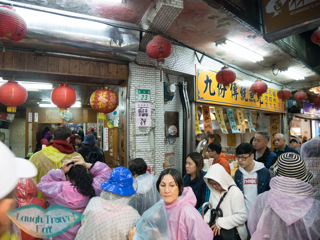 busy food store on jiufen old street ruifang taiwan - Laugh Travel Eat