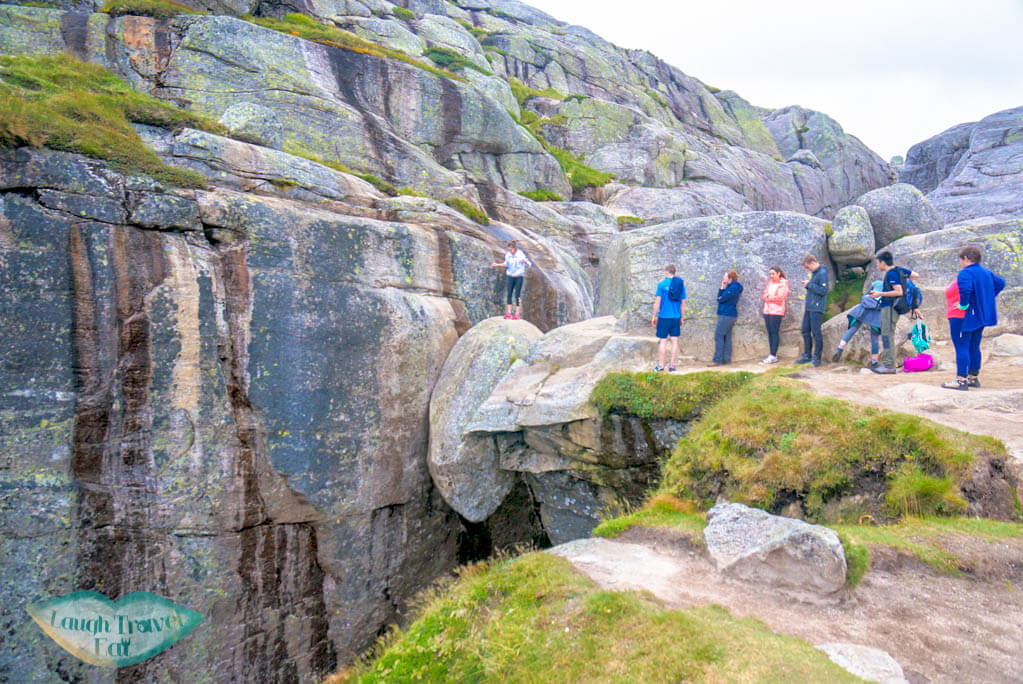 Queuing for the shot at kjeragbolten hike norway europe | Laugh Travel Eat