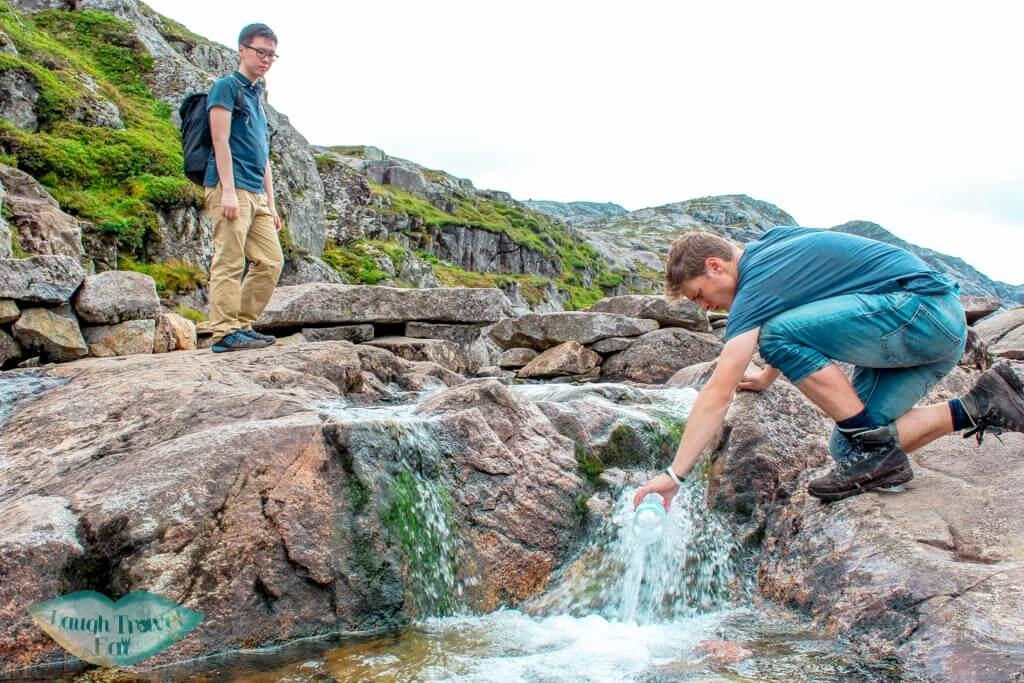 filling up water bottle at the stream kjeragbolten hike norway europe | Laugh Travel Eat
