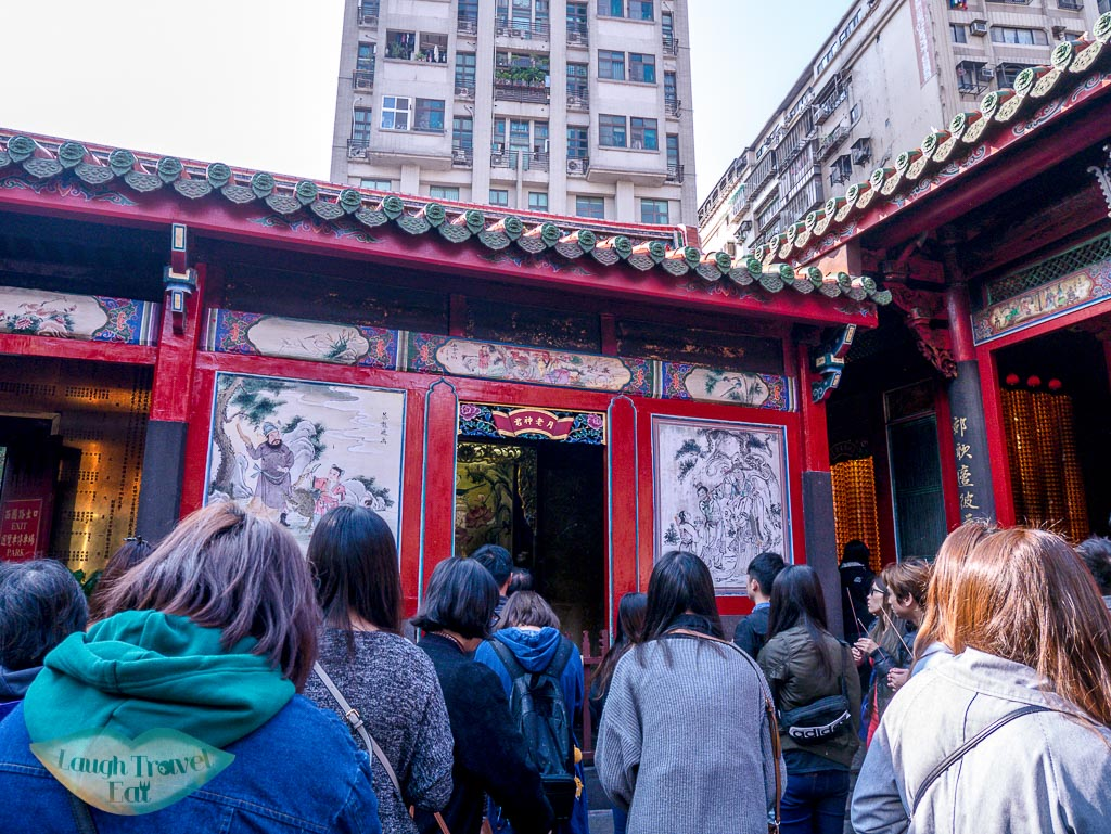 chinese cupid lungshan temple taipei taiwan - laugh travel eat