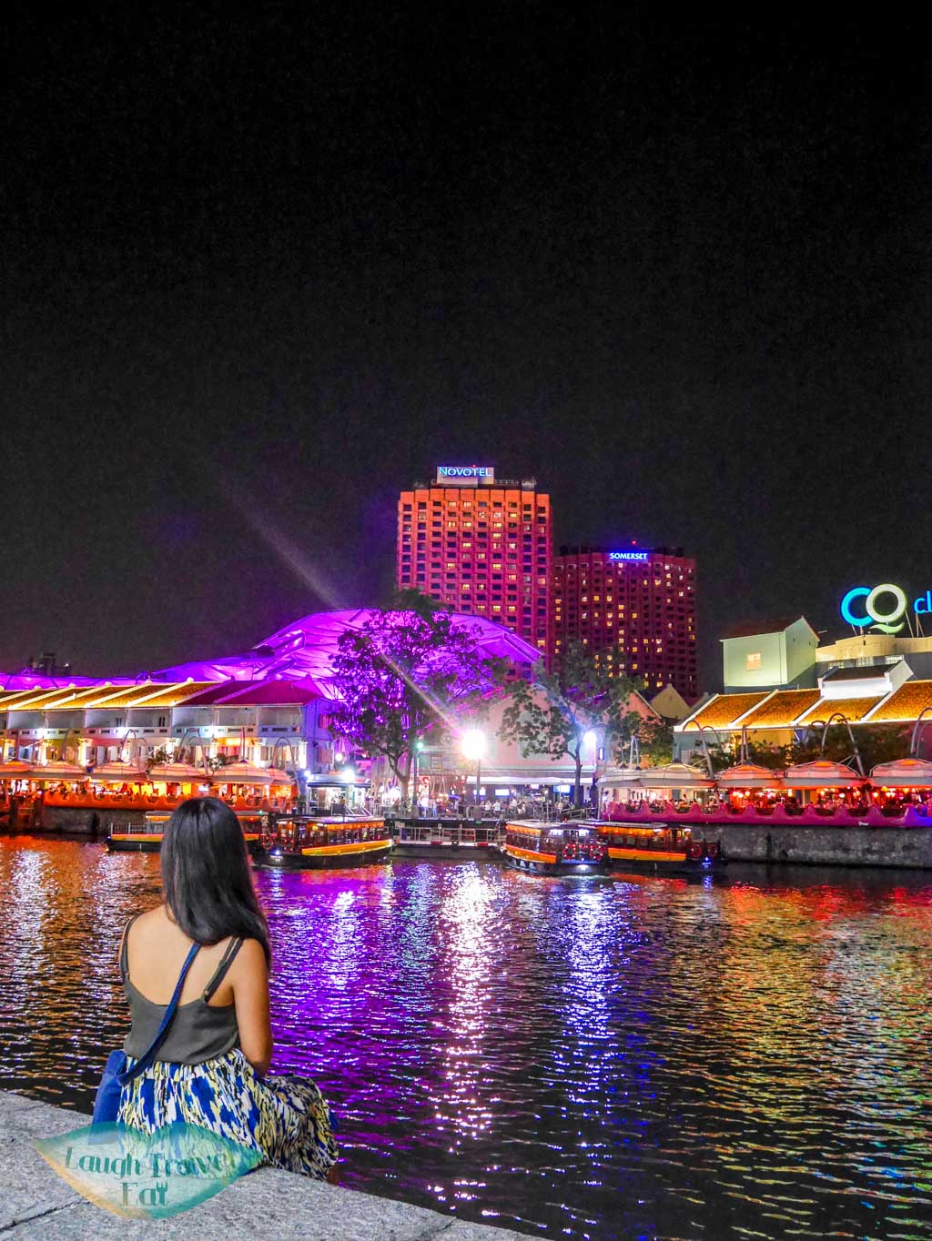 photo of me by a stranger at clarke quay singapore - laugh travel eat
