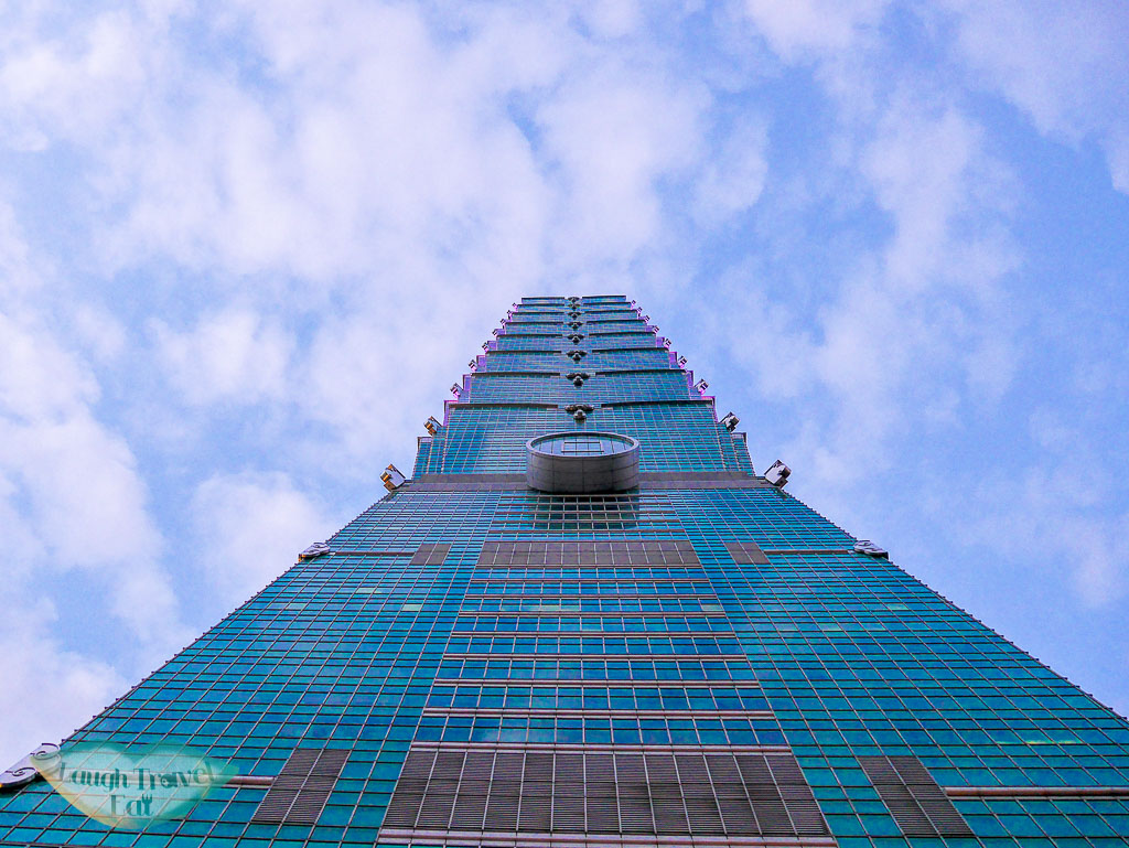 taipei 101 from below taipei taiwan - laugh travel eat
