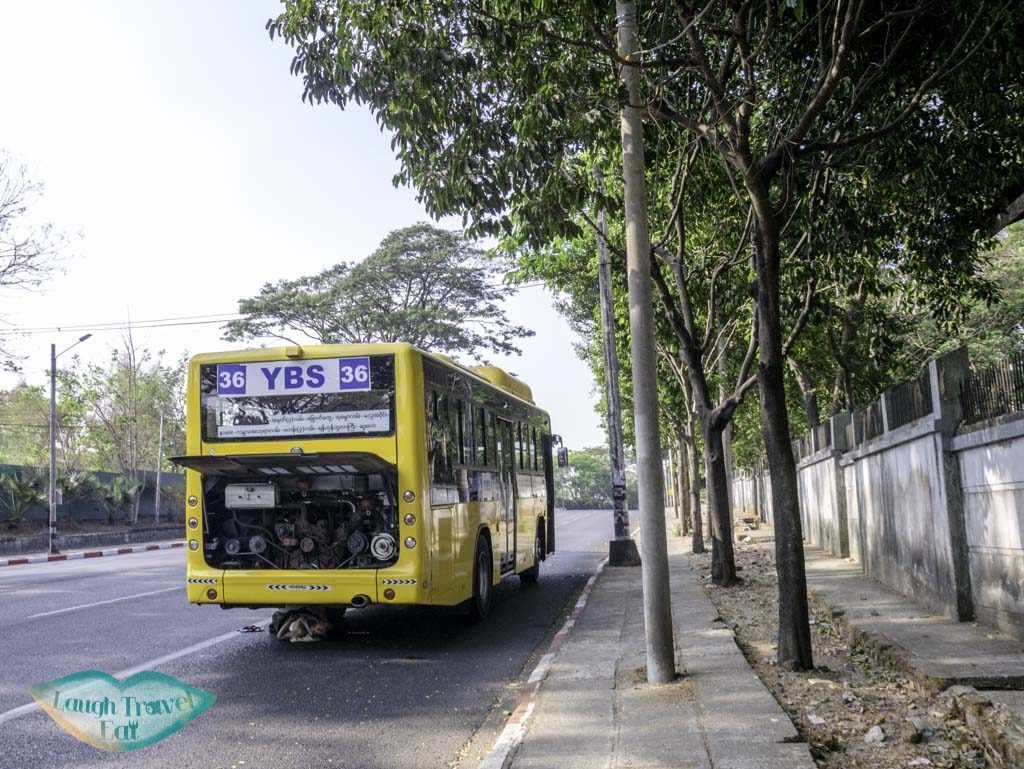 a bus broekn down by the side of the road yangon myanmar - laugh travel eat