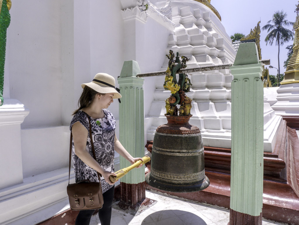 bell ringing in shwedagon pagoda yangon myanmar - laugh travel eat