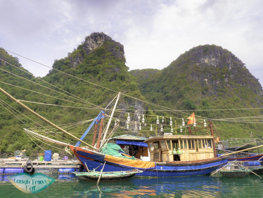 boat-with-kerosene-lamps-in-Cua-Van-Floating-village-on-bamboo-boats-paradise-elegance-halong-bay-vietnam-laugh-travel-eat
