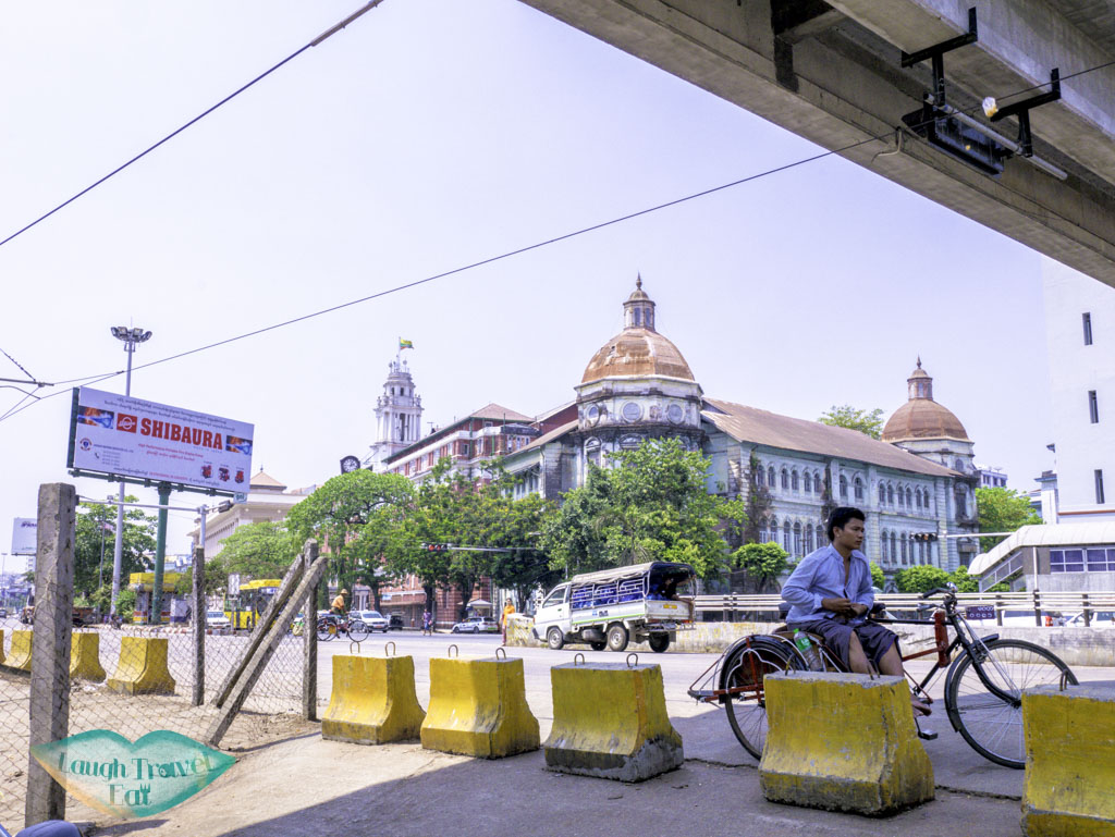 colonial building downtown yangon myanmar - laugh travel eat