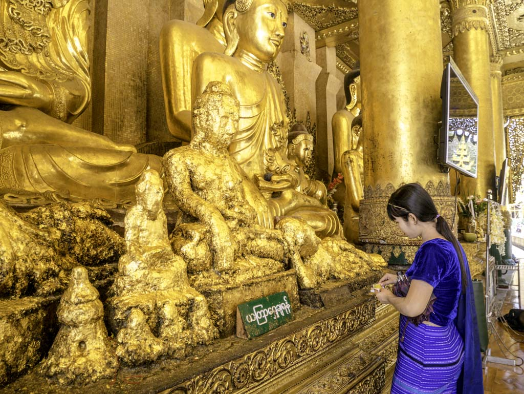 gold leaves being left in shwedagon pagoda yangon myanmar - laugh travel eat