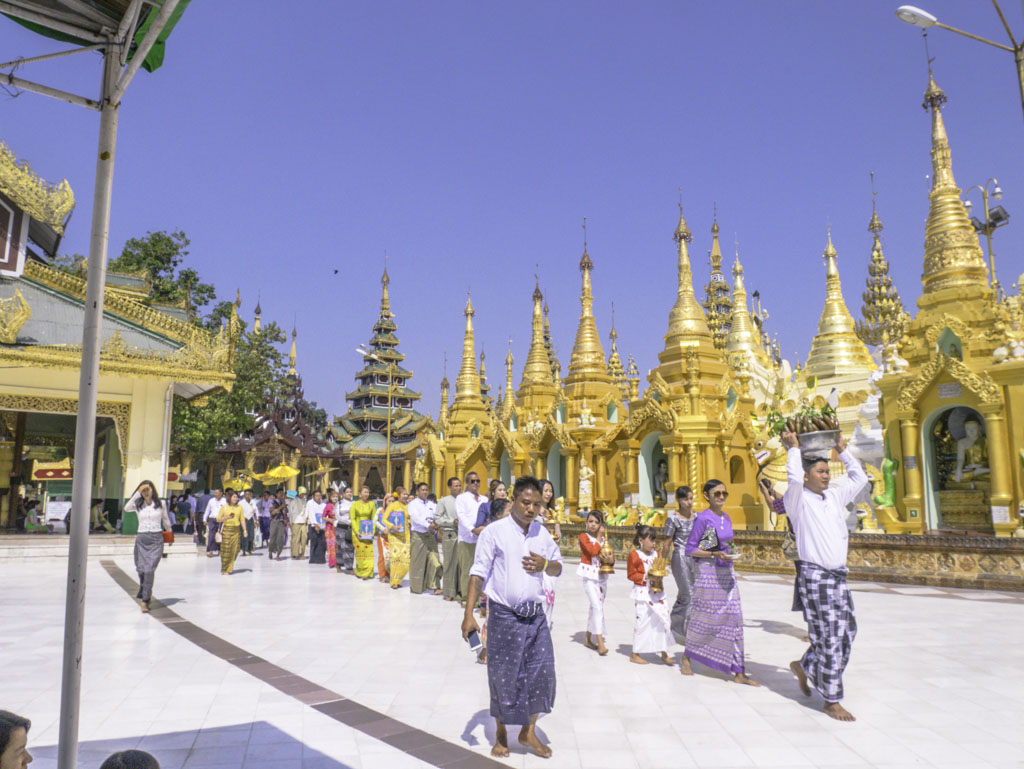 religion processions in shwedagon pagoda yangon myanmar - laugh travel eat