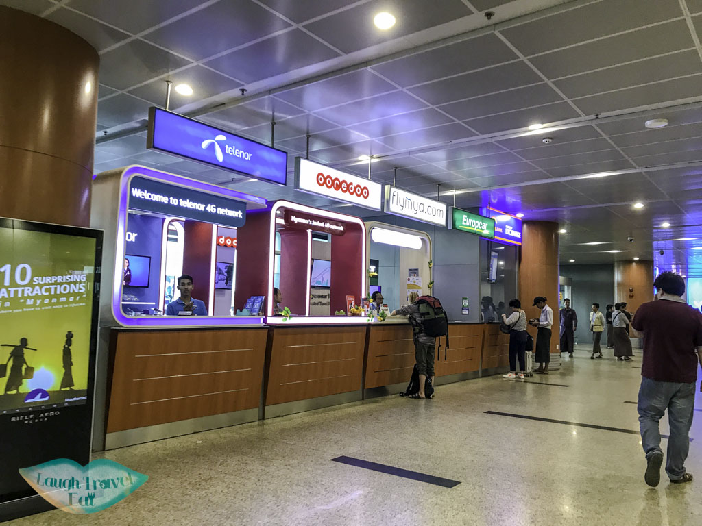 telenor and other telecommunication provider at yangon airport yangon myanmar - laugh travel eat