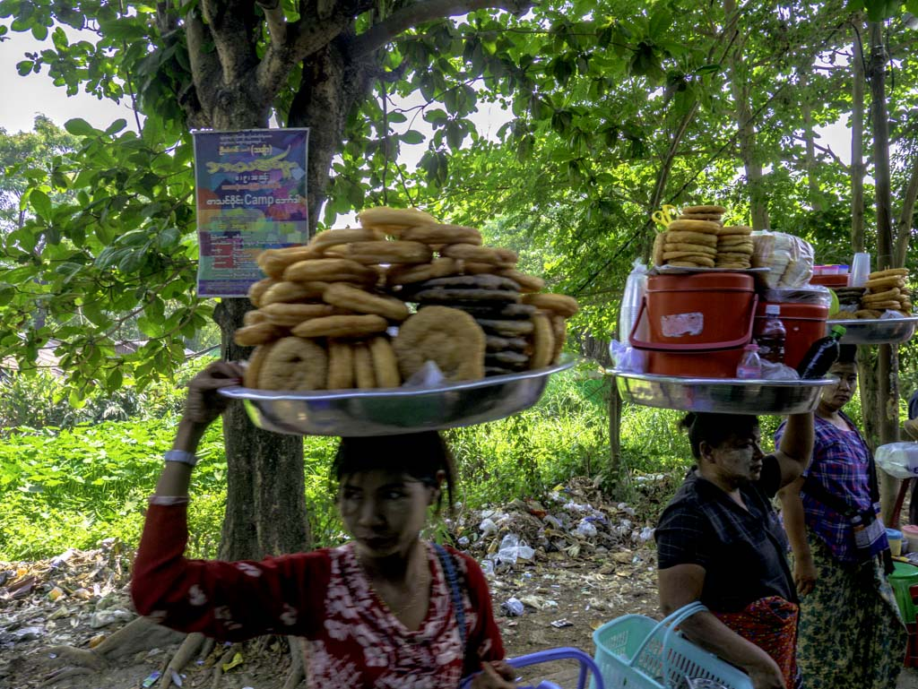 women carrying snacks to get on circle train yangon myanmar - laugh travel eat