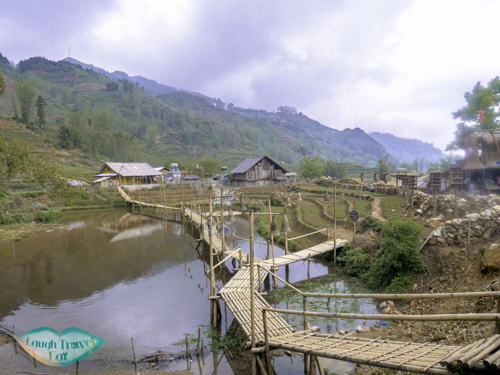 bamboo-walkway-in-pond-cat-cat-village-sapa-northern-vietnam-laugh-travel-eat