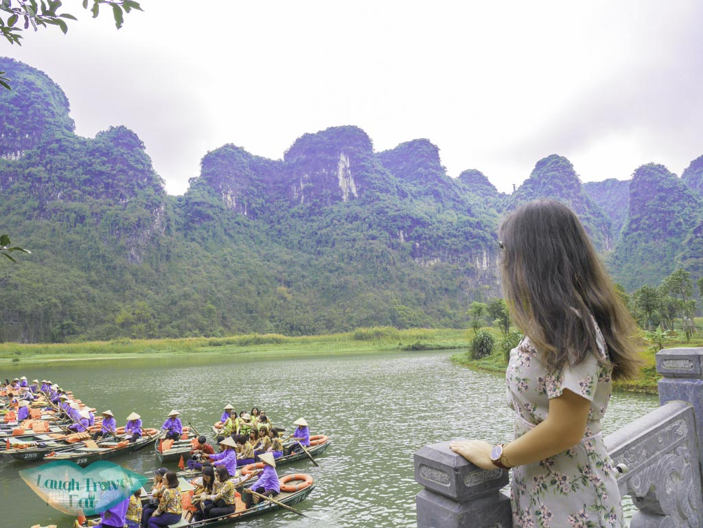 on-a-bridge-at-trang-an-grottoes-ninh-binh-vietnam-Laugh-Travel-Eat