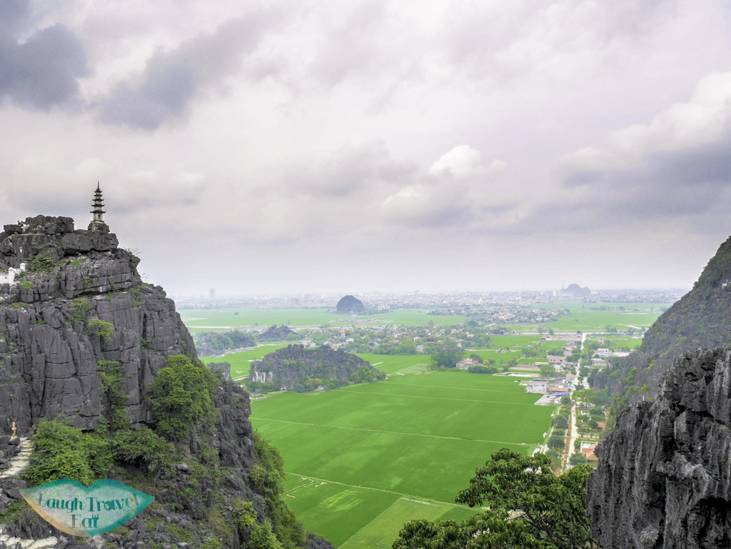 peak-with-pagoda-on-lying-dragon-mountains-mua-cave-ninh-binh-vietnam-Laugh-Travel-Eat