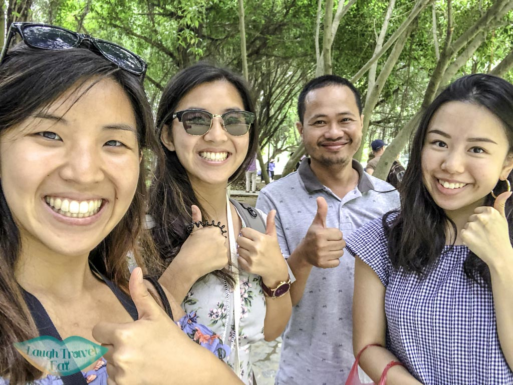 photo-with-our-vietnamese-dad-at-trang-an-grottoes-ninh-binh-vietnam-Laugh-Travel-Eat