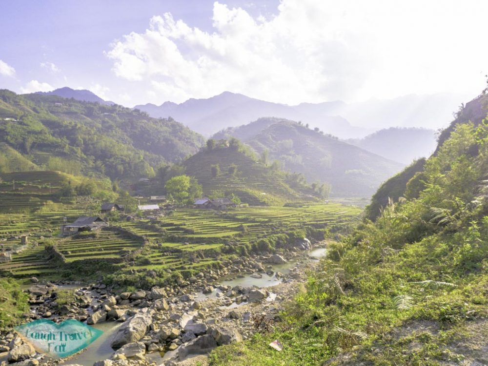 rice-paddies-with-strewam-on-our-trek-sapa-northern-vietnam-laugh-travel-eat