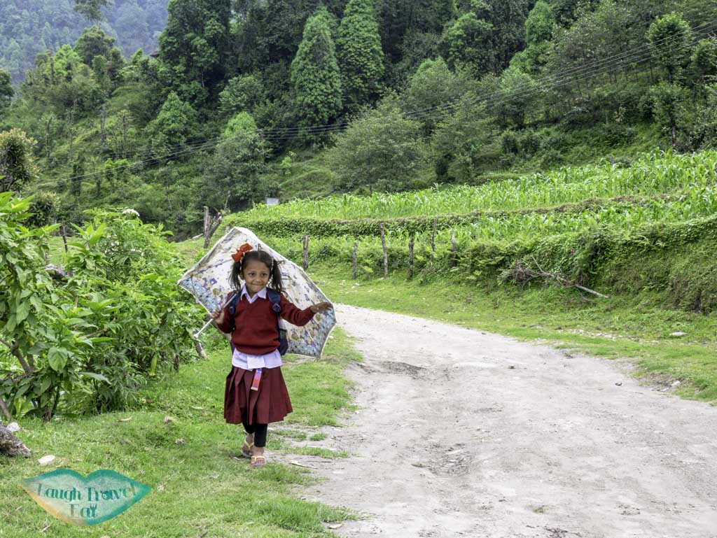 cute-school-girl-Poon-Hill-Trek-Annapurna-Conservation-Area-Nepal-laugh-travel-eat