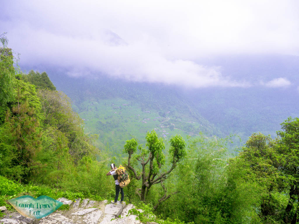 porter-along-the-trail-Poon-Hill-Trek-Annapurna-Conservation-Area-Nepal-laugh-travel-eat
