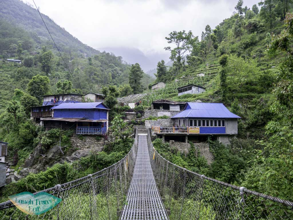 suspension-bridge-along-Poon-Hill-Trek-Annapurna-Conservation-Area-Nepal-laugh-travel-eat