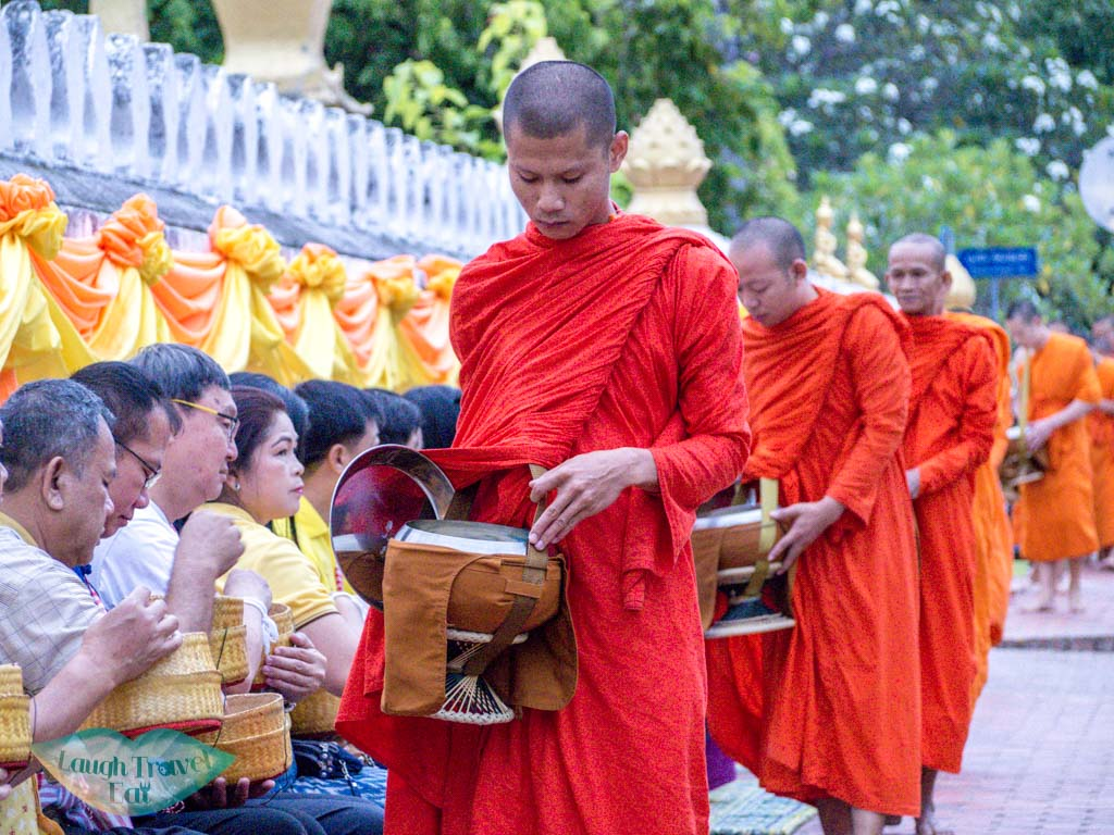 monks receiving alms luang prabang laos - laugh travel eat