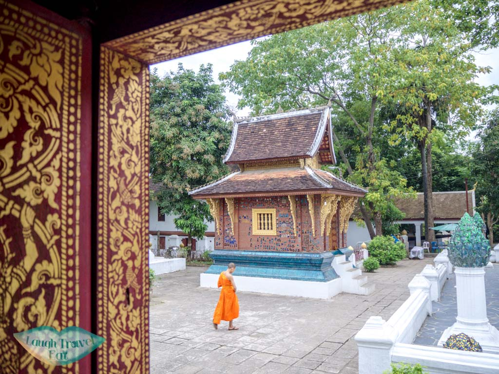 looking frm one prayer hall to another at Wat Xiengthong luang prabang laos - laugh travel eat