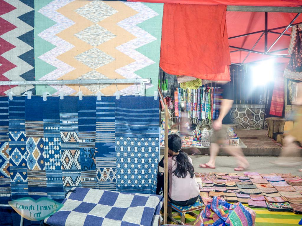 textile at night market luang prabang laos - laugh travel eat