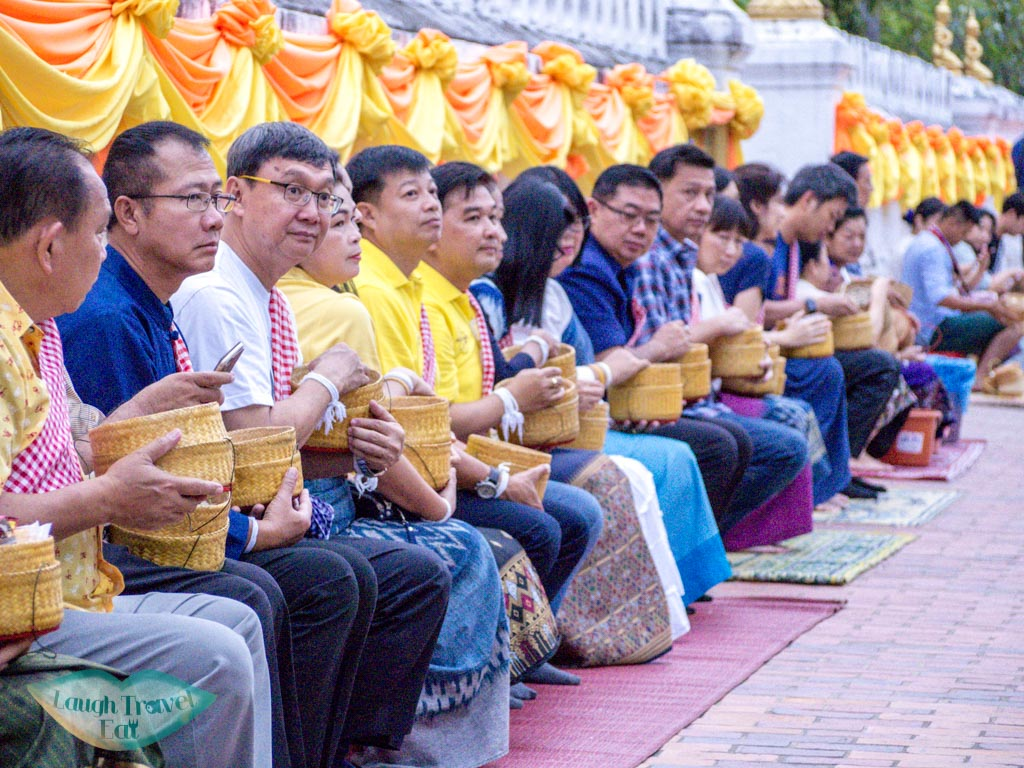 waiting for the alms giving ceremony luang prabang laos - laugh travel eat