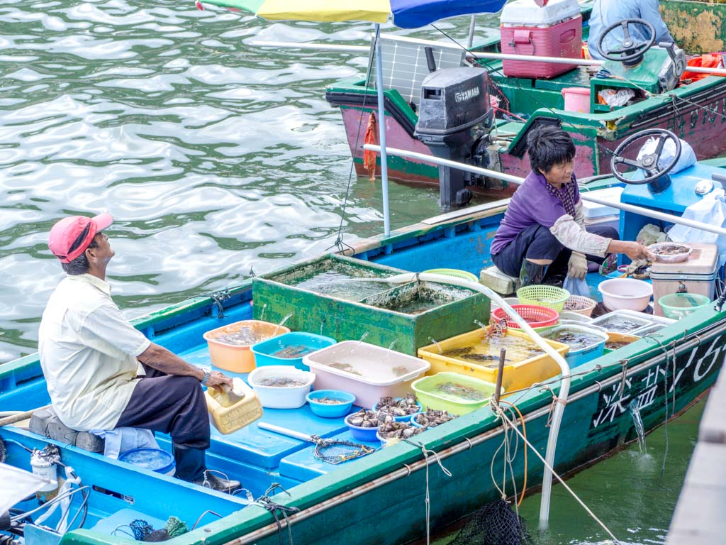 fisherman-on-boat-sai-kung-hong-kong-Laugh-Travel-Eat