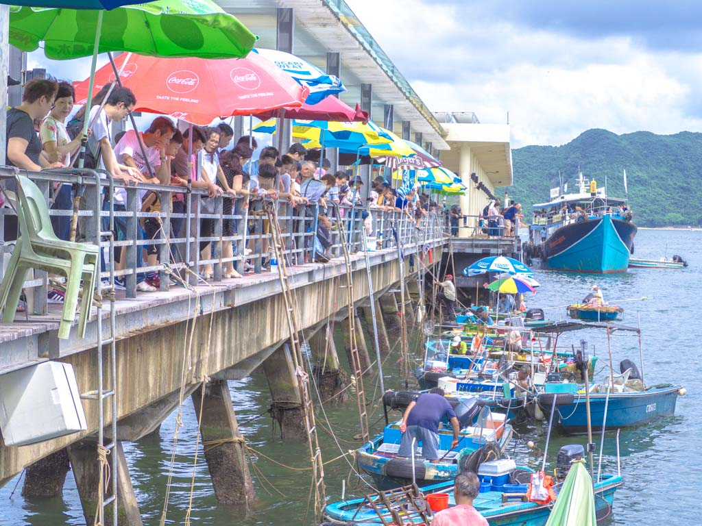 fisherman-selling-catch-by-pier-sai-kung-hong-kong-Laugh-Travel-Eat