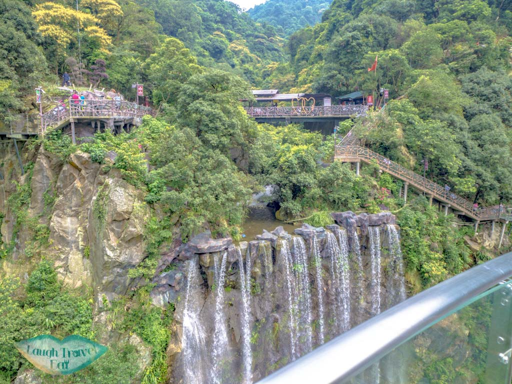 view-of-waterfall-from-glass-platform-ancient-dragon-canyon-qingyuan-china-laugh-travel-eat