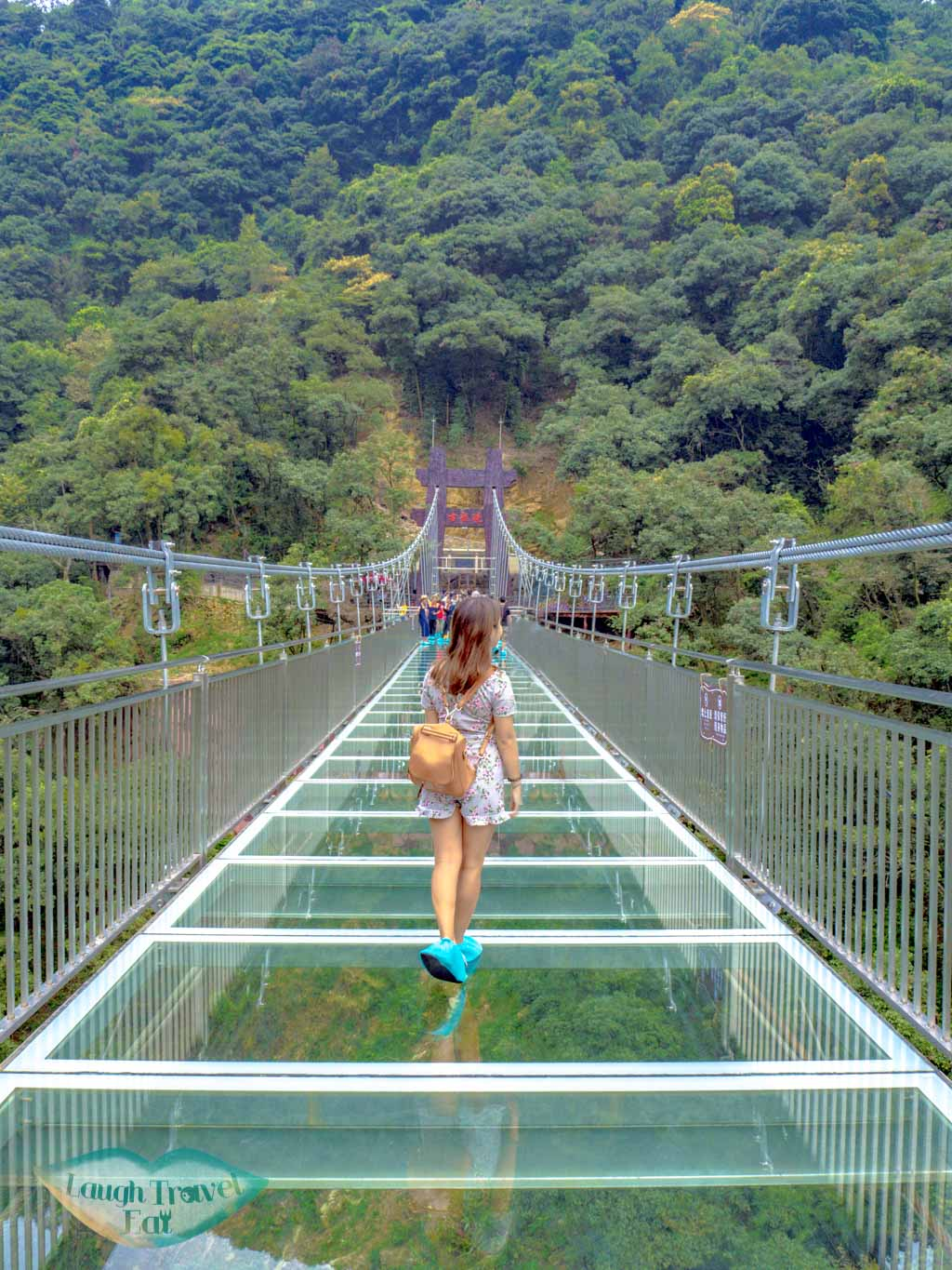 walking-on-the-glass-bridge-in-ancient-dragon-canyon-qingyuan-china-laugh-travel-eat