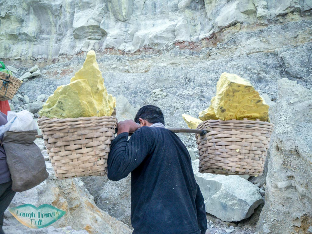 sulfur-miners-carrying-sulfur-out-of-crater-kawah-ijen-java-indonesia-laugh-travel-eat