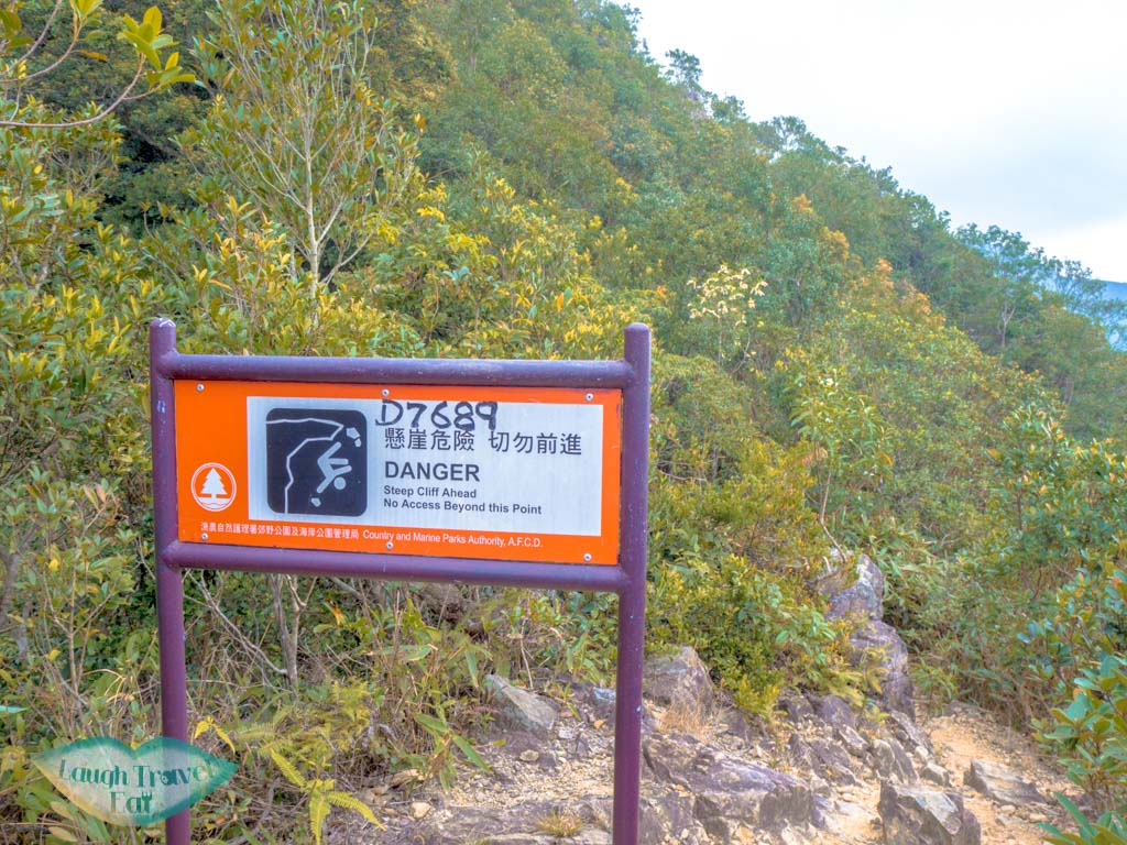 warning-sign-along-tiu-shau-ngam-mos-hike-hong-kong-laugh-travel-eat