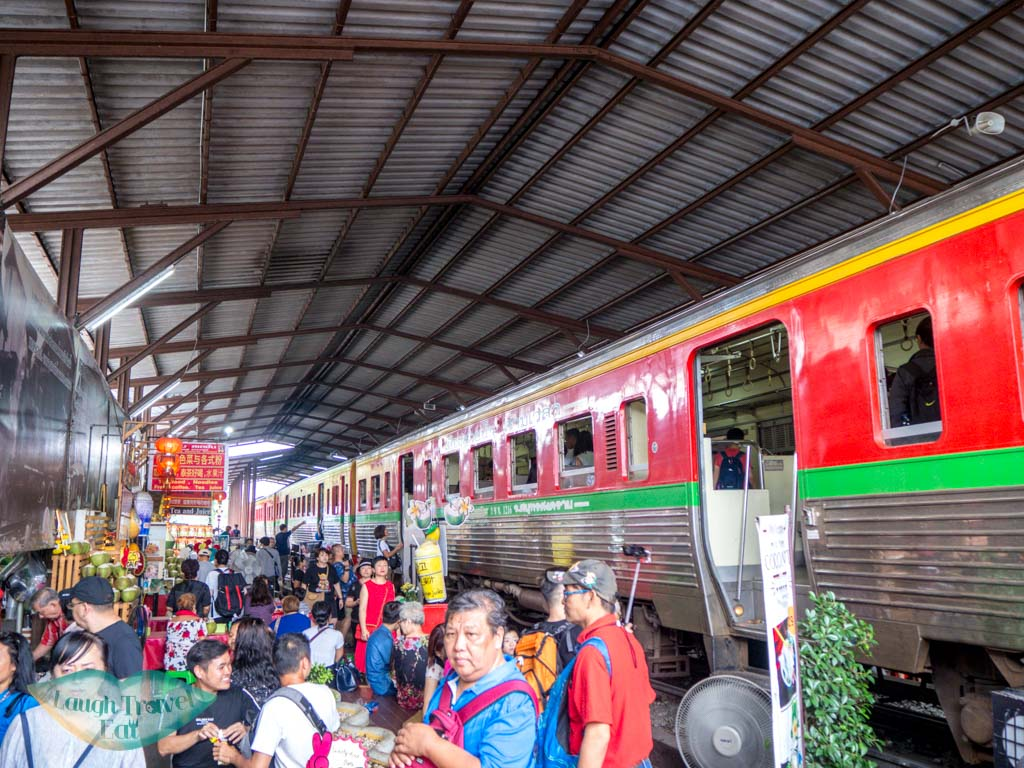 chaos-getting-off-train-at-mekong-railway-market-bangkok-thailand-laugh-travel-eat