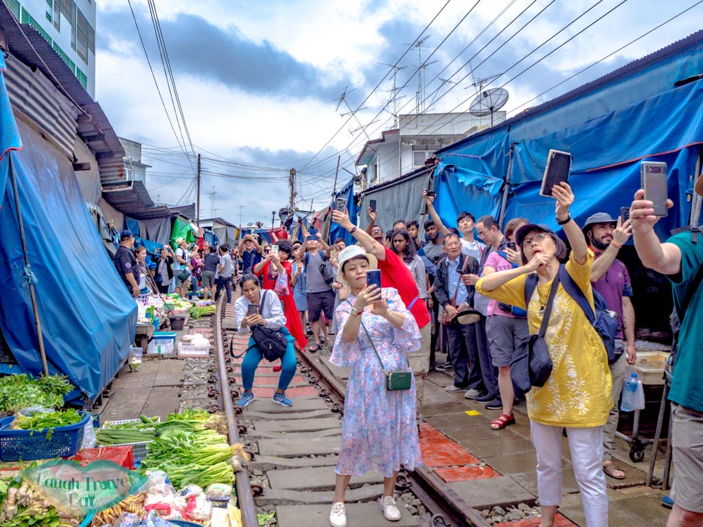 crowds-at-mekong-railway-market-bangkok-thailand-laugh-travel-eat