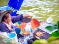 women-grilling-seafood-on-boat-at-amphawa-floating-market-bangkok-thailand-laugh-travel-eat