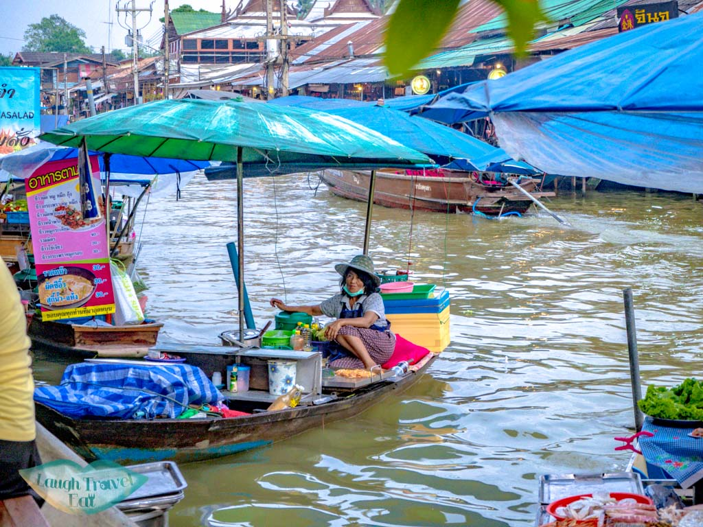 women-on-boat-at-amphawa-floating-market-bangkok-thailand-laugh-travel-eat