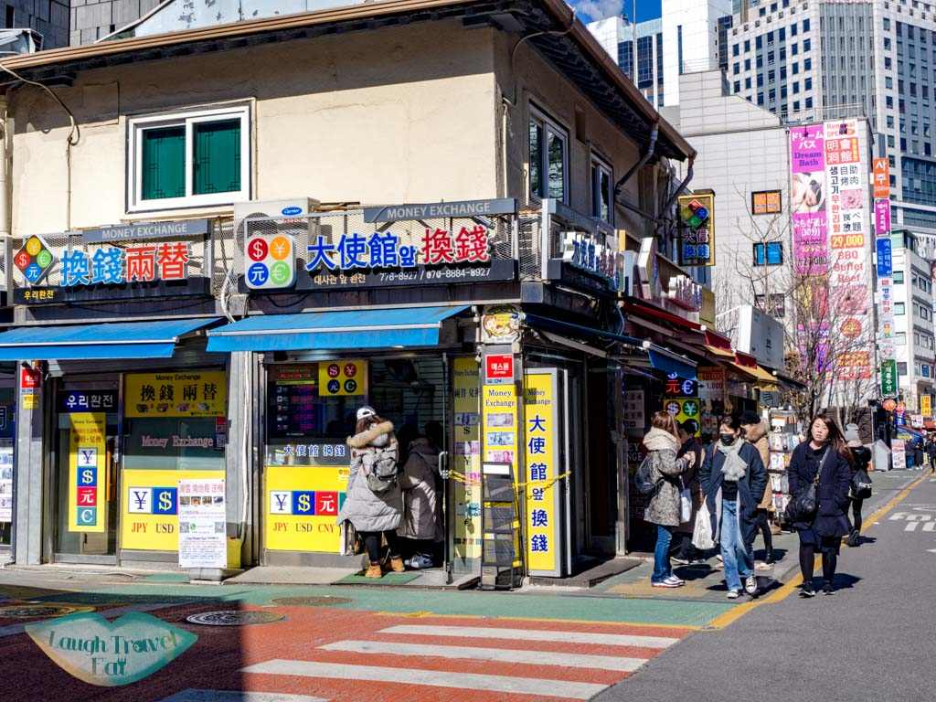 currency-exchange-myeongdong-seoul-south-korea-laugh-travel-eat