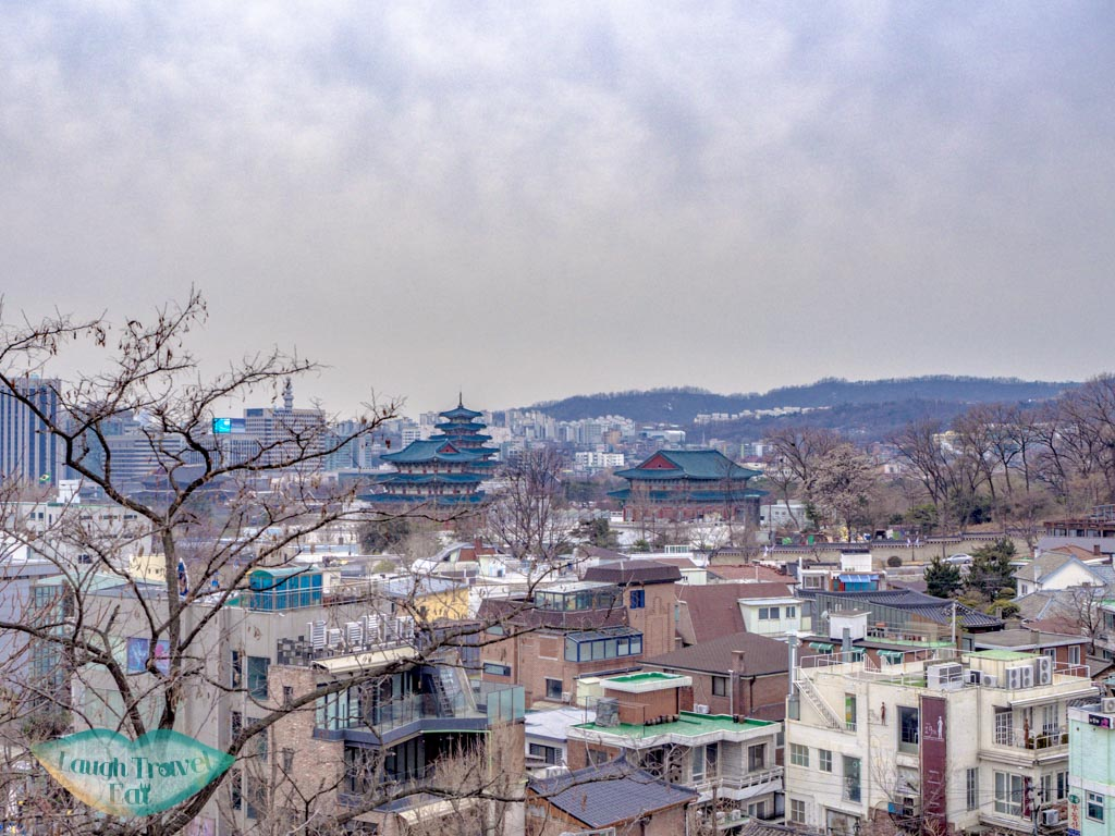 view-of-palace-from-hanok-village-seoul-south-korea-laugh-travel-eat