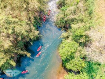 drone-shot-of-kayaking-on-nam-ha-river-nam-ha-national-park-luang-namtha-laos-laugh-travel-eat