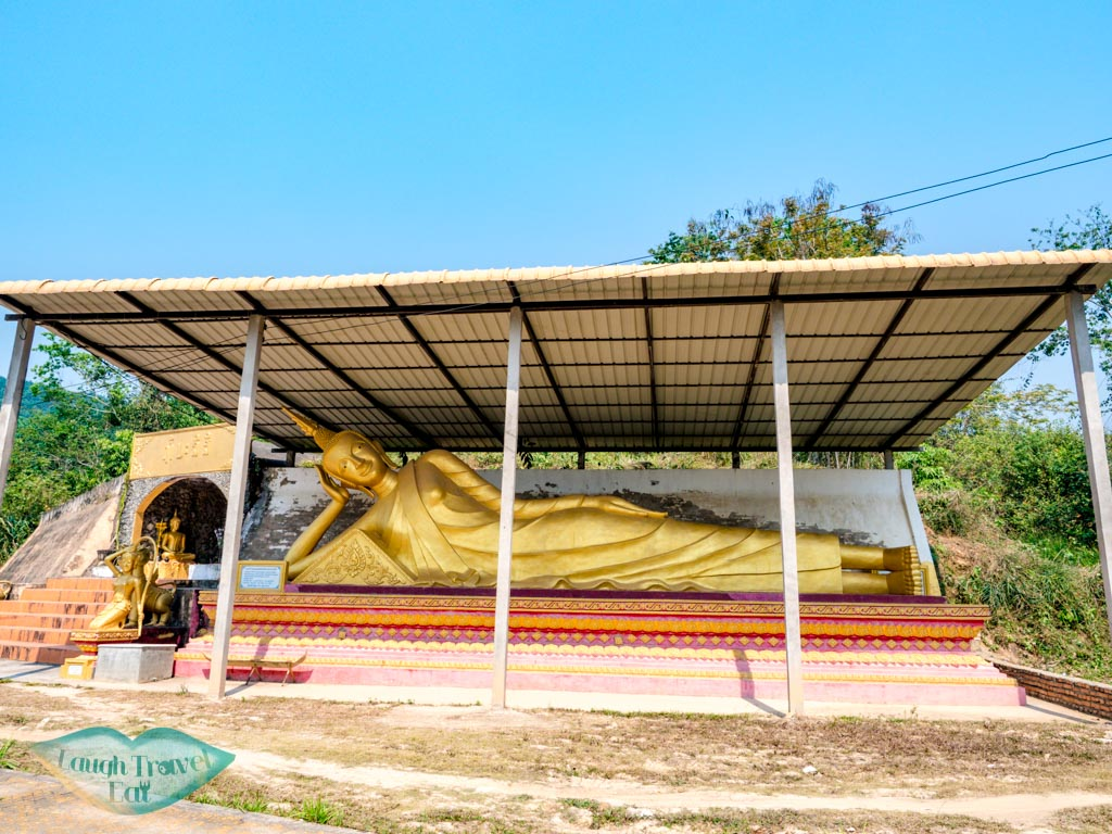 reclining-buddha-and-small-cave-luang-namtha-stupa-luang-namtha-laos-laugh-travel-eat