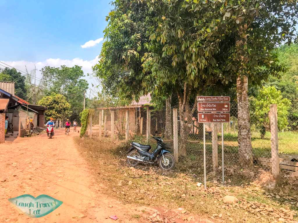 brown-valley-cycling-route-sign-luang-namtha-laos-laugh-travel-eat