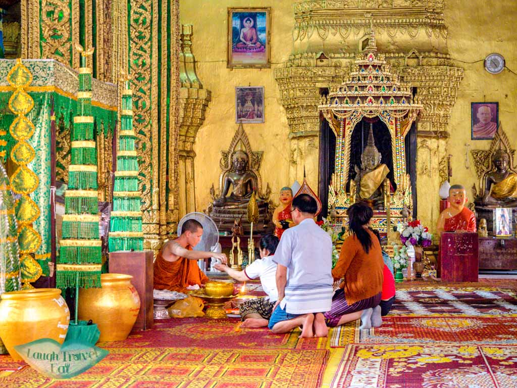 inside-wat-si-muang-vientiane-laos-laugh-travel-eat