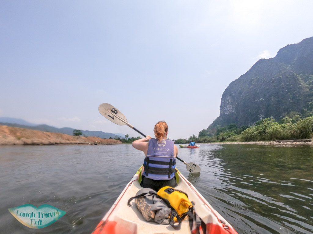 kayaking-on-nam-song-river-vang-vieng-laos-laugh-travel-eat