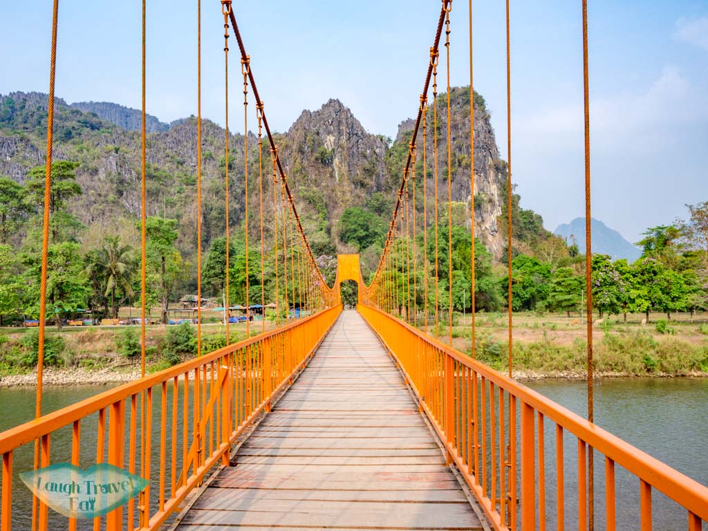 orange-suspension-bridge-vang-vieng-laos-laugh-travel-eat