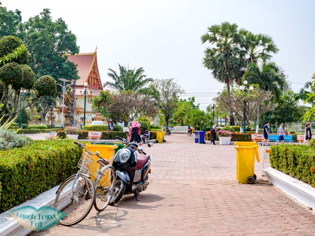 parking-bicycle-outside-pha-that-luang-vientiane-laos-laugh-travel-eat