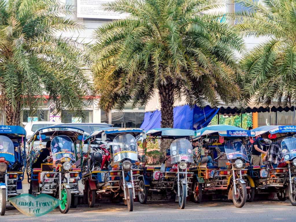 row-of-tuk-tuk-on-the-street-vientiane-laos-laugh-travel-eat