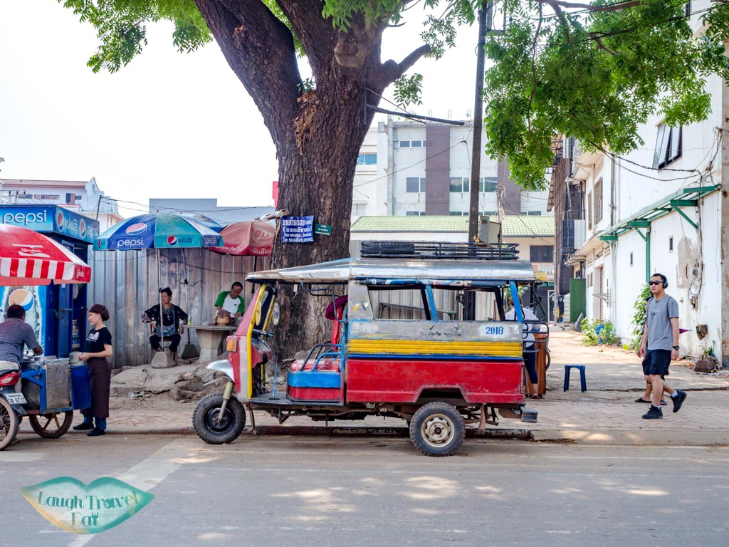 tuk-tuk-on-the-street-vientiane-laos-laugh-travel-eat